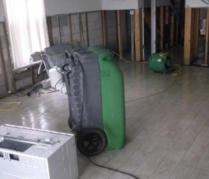 SERVPRO drying equipment setup in the office to dry the water